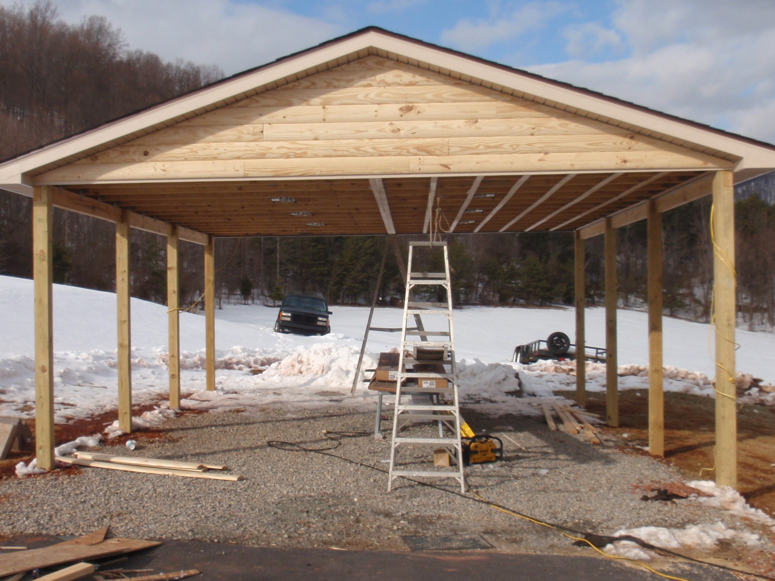 Double d contracting log siding carport to match home for Log carports